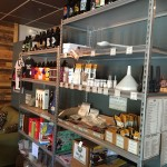 Shelves full of homebrewing supplies stand ready.
